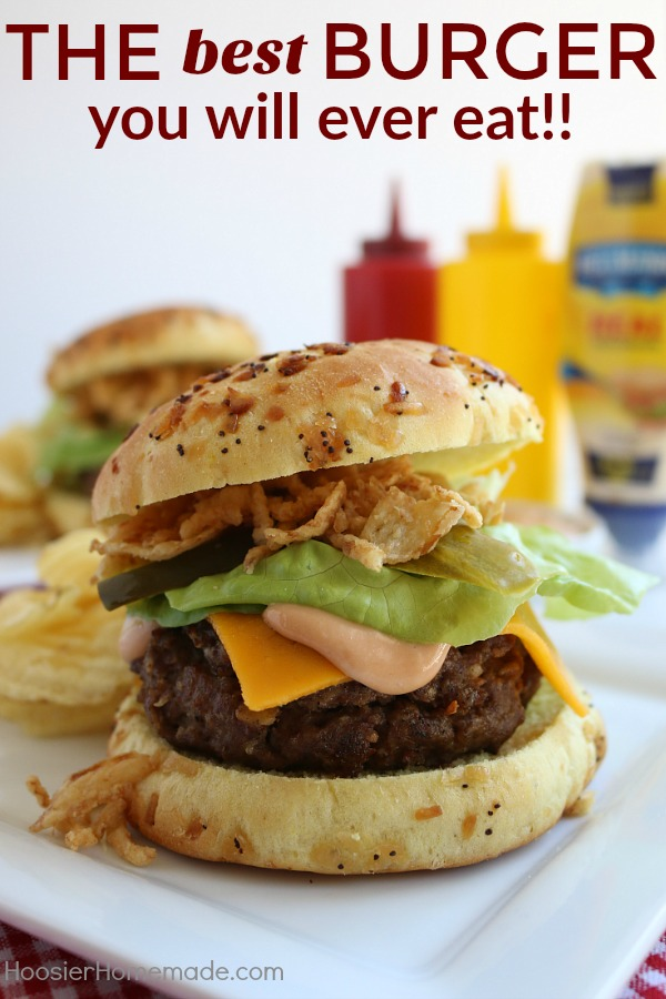 This All-American Barbecue Burger is the BEST you will ever eat! Made with a secret ingredient and piled high with barbecue/mayo sauce, cheese, lettuce and pickles all on a special onion bun!