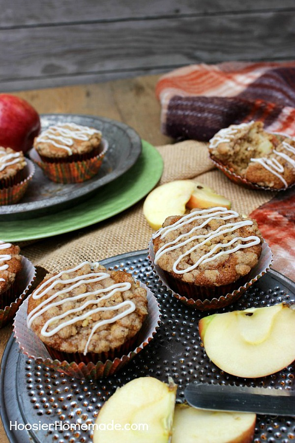 APPLE CRUMBLE CUPCAKES -- These Apple Pie Cupcakes aren't your ordinary cupcakes! The combination of chopped apples and applesauce makes these Apple Cupcakes moist and flavorful. The crumble topping adds a bit of crunch that pairs perfectly with the cinnamon and nutmeg in the cupcakes.
