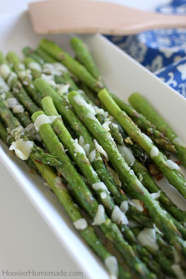Baked Asparagus with Garlic and Cheese on serving plate