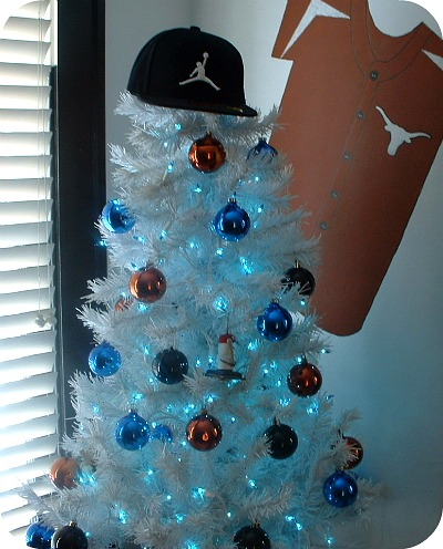 so their baseball tree is white with blue lights and ornaments a few baseball ornaments orange and black balls for