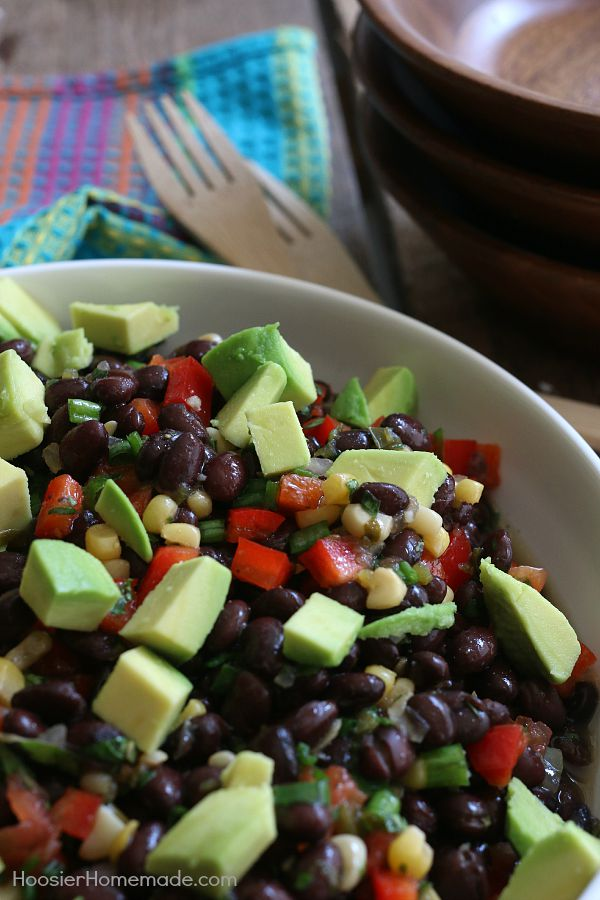This Black Bean and Corn Salad couldn't be easier! With just a handful of ingredients, this delicious salad goes together in minutes! Perfect for parties, potlucks, tailgating, cookouts and more! Click on the Photo for Recipe!