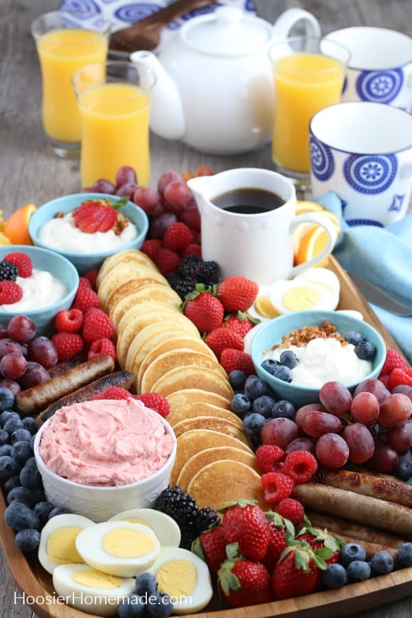 Breakfast Charcuterie Board with pancakes, meat, fruit and yogurt