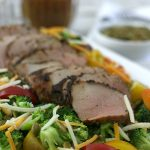 This Broccoli Tomato Salad with Pork Tenderloin is easy enough to make for a weeknight dinner yet elegant enough to serve to guests!