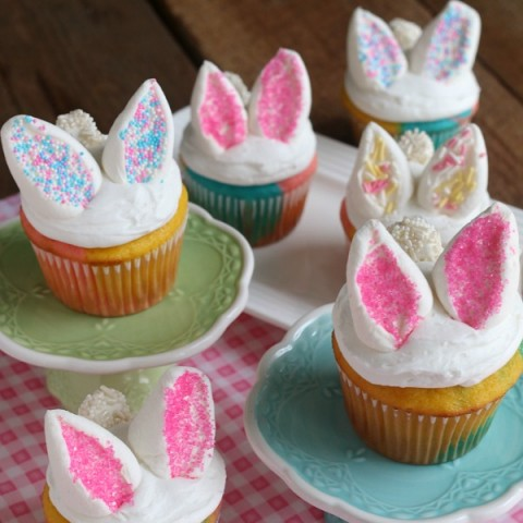 These Easy Bunny Cupcakes are perfect for Easter or Spring! They start with a 3-color cupcakes, white frosting and marshmallow bunny ears and tail. The kids will have a blast helping with these Easter Cupcakes!