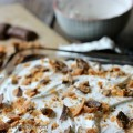 Butter Pecan Cake: Yellow Poke Cake flavored with Southern Butter Pecan Creamer, topped with Fluffy Frosting and chopped Butterfinger Candy Bars | Recipe on HoosierHomemade.com
