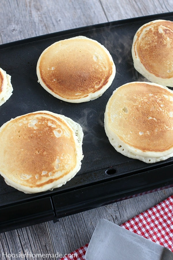 Buttermilk Pancakes cooking on griddle