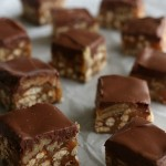 Caramel - Pecans - Pretzels - Chocolate = YES please! This no bake cookie recipe, Caramel Pecan Pretzel Bars are perfect any time of year! They are easy to make and one batch makes a enough to enjoy and share! They are a MUST to add to your Holiday Baking list!