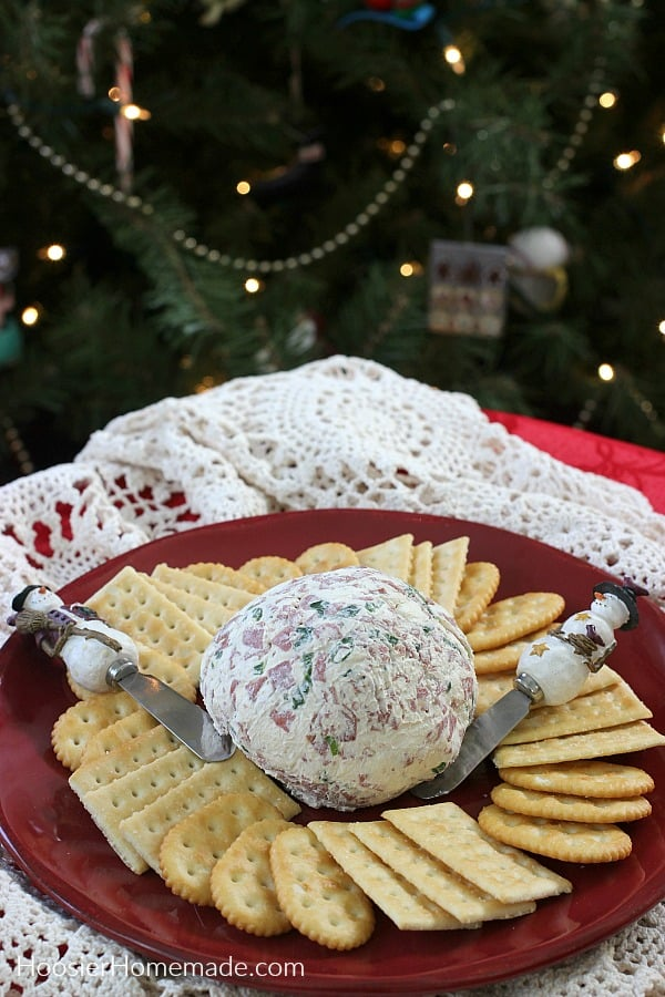 Cheese Ball on plate by Christmas tree