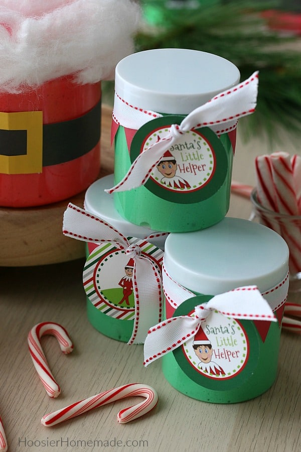 Containers of Christmas Slime decorated in Santa and Elf