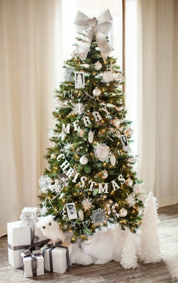 This gorgeous white Christmas Tree would go perfectly in any home. Visit our 100 Days of Homemade Holiday Inspiration for more recipes, decorating ideas, crafts, homemade gift ideas and much more!