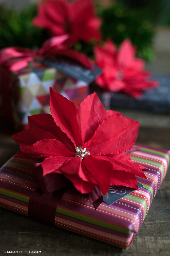 Learn to make this beautiful Paper Poinsettia from a cocktail napkin! Perfect for decoration or on top of gifts! Pin to your Christmas Board!