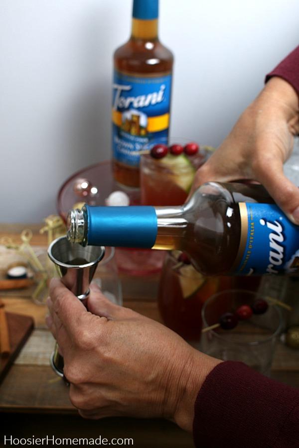 Pouring Torani Syrup