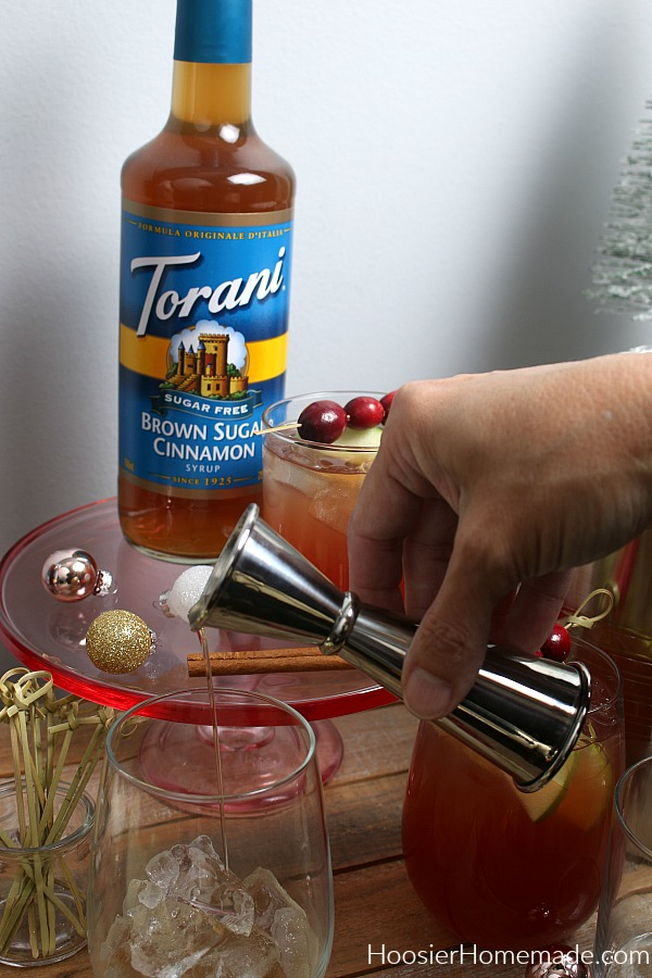 Pouring syrup into glass