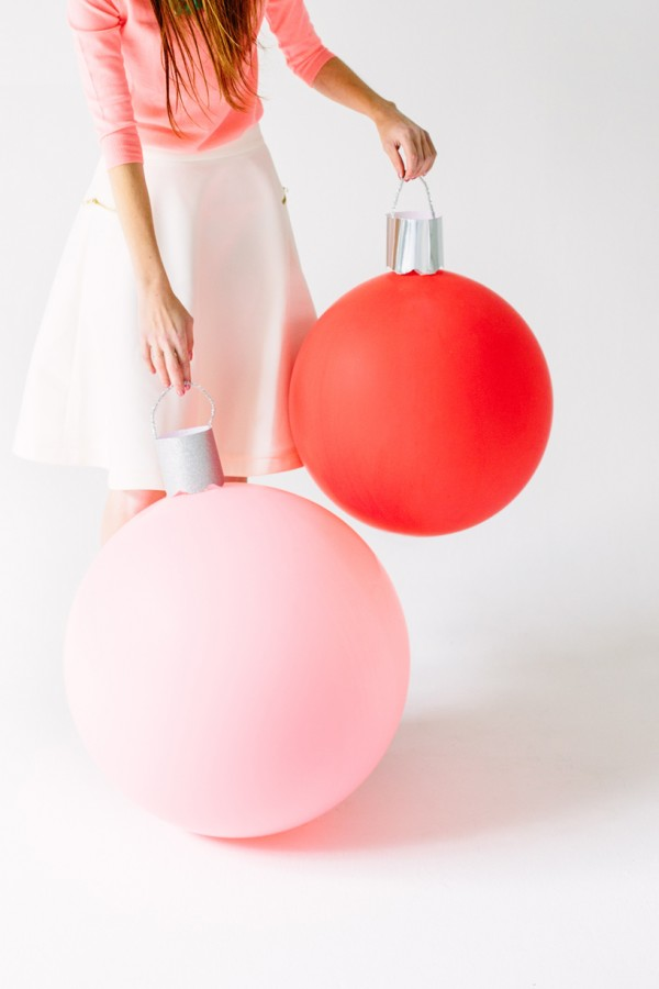 These DIY Giant Ornament Balloons are such a fun way to decorate for the holidays! They are SUPER easy to put together with just a few simple supplies! Visit our 100 Days of Homemade Holiday Inspiration for more recipes, decorating ideas, crafts, homemade gift ideas and much more!