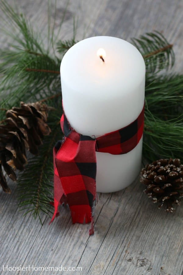 Candle with fabric ribbon