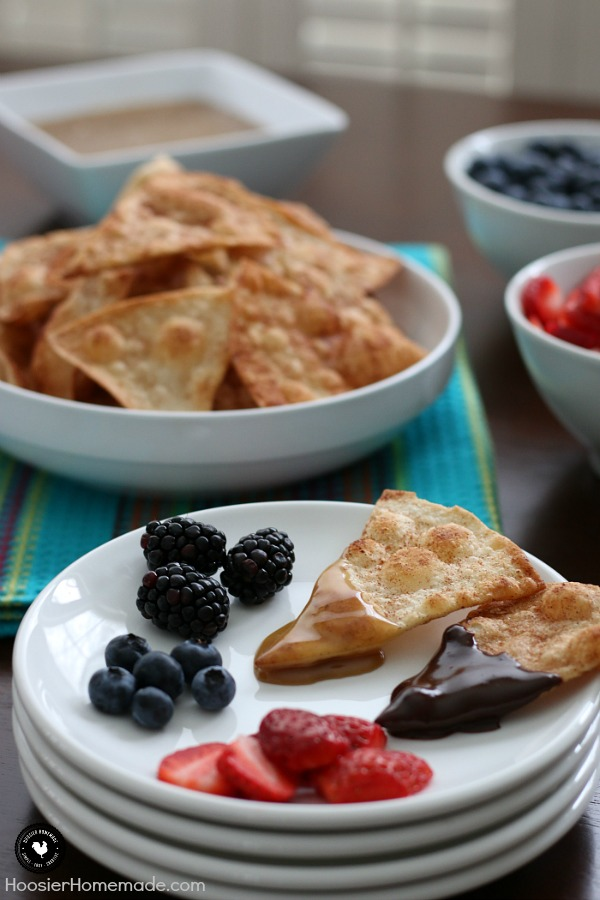 Wow the football fans with this simple and sweet Tortilla Chip Dessert Fondue! The cinnamon and sugar tortilla chips are easy to make and the homemade caramel and Mexican chocolate sends it over the top. Oh and we can't forget the fruit for a little burst of freshness!