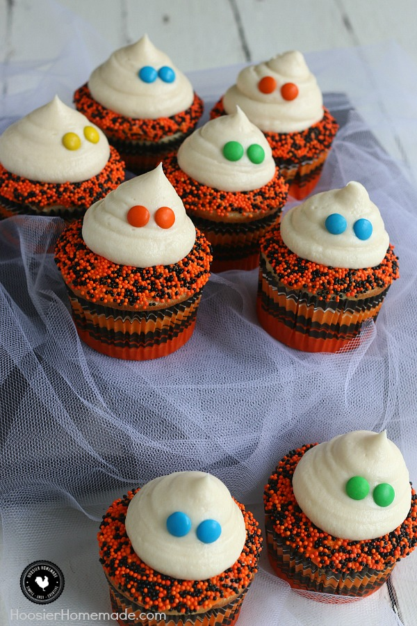 These cute little Ghost Cupcakes are super easy - even the kids can help decorate them! They are perfect for Halloween parties, classroom treats and more! Whip up a batch with simple supplies!
