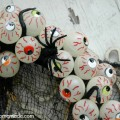Halloween Craft - Easy to make Eyeball Wreath that Glows-in-the-Dark | Instructions on HoosierHomemade