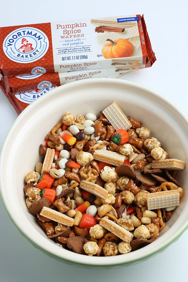 Fall snack mix in large green bowl