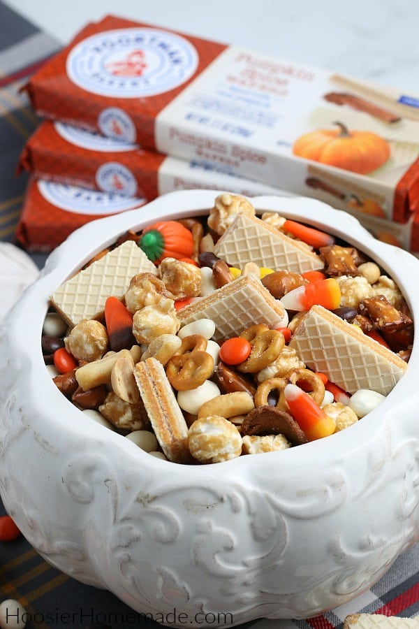 Snack Mix for Halloween in white ceramic pumpkin