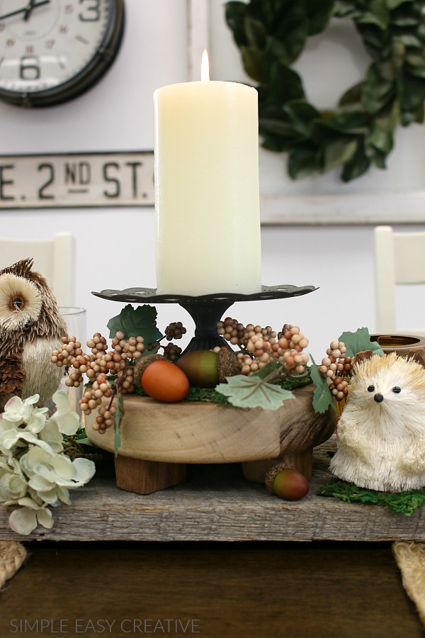Adding candles to Fall Table Decorations