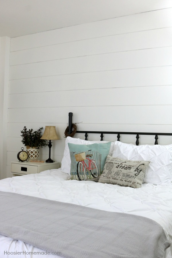 Get the Farmhouse Decor look for a fraction of the cost! Learn how to create the look yourself including a DIY Shiplap Wall for under $40 and a $10 brass headboard painted! Add fun accessories to create the Farmhouse Style Bedroom of your dreams!