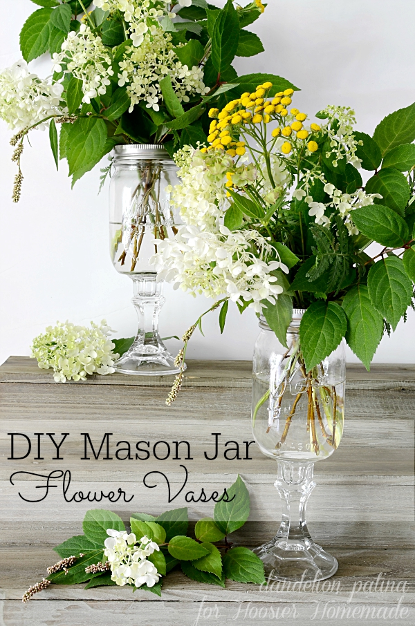 Gorgeous right? These farmhouse style flower arrangements were created along with the DIY mason jar vases to infuse your home with farmhouse style. Project created by Dandelion Patina for Hoosier Homemade. #masonjars #farmhousestyle