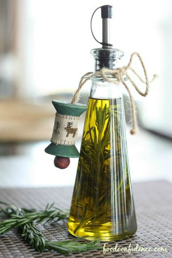 Rosemary infused Olive Oil makes a great food gift for the holidays! It's easy and tastes great! Visit our 100 Days of Homemade Holiday Inspiration for more recipes, decorating ideas, crafts, homemade gift ideas and much more!