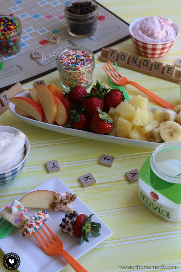 Create this fun Fruit Dip Fondue and I guarantee the kids will eat their fruit! Made with just 3 ingredients - the Fruit Dip Recipe is out-of-this-world delicious! Add fun toppings for dipping too! Perfect for game night, after-school treat, parties, holidays and more!