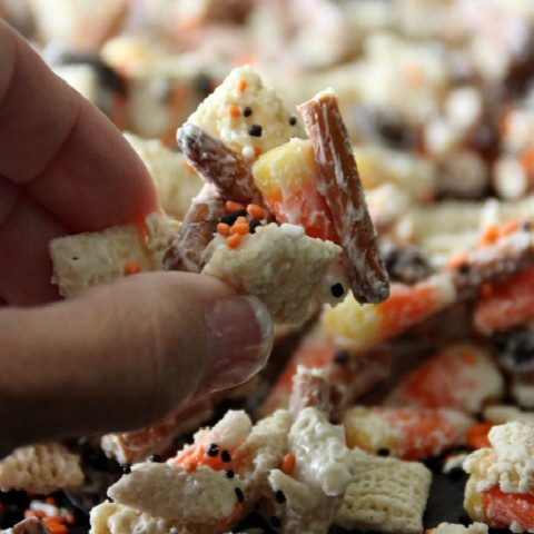Whip up this fun Halloween Treat in about 15 minutes! Kids and adults will love this Candy Corn Party Mix! Pin it to your Halloween Board!