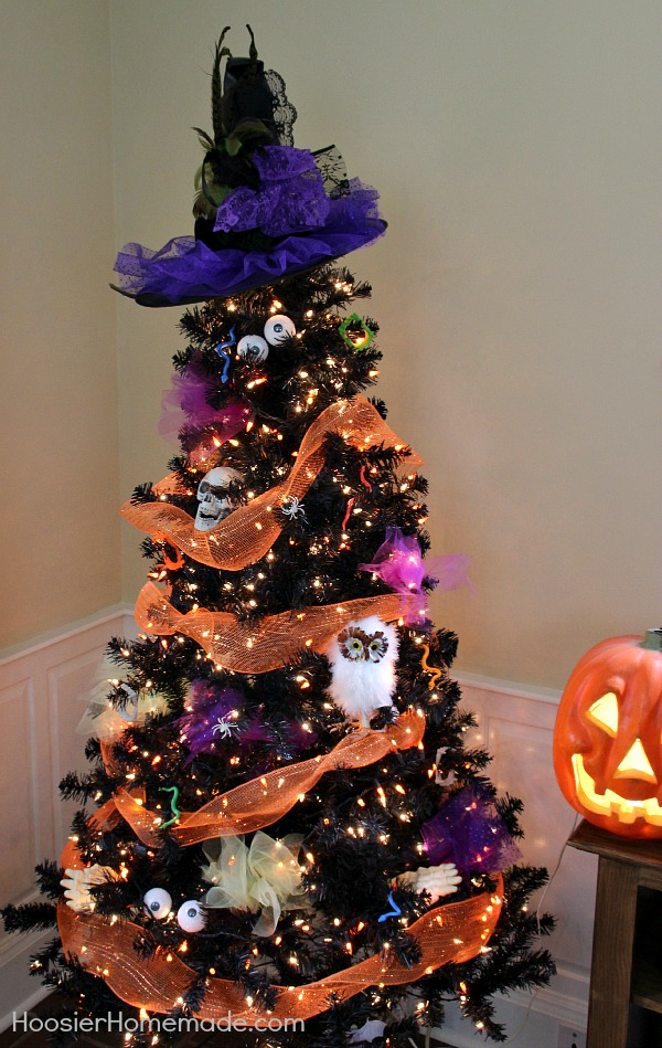 Halloween Tree - Orange Deco Mesh, Skulls, Eyes, Spiders and more are used to decorate the Halloween Tree, and topped with a cool Witches Hat. Get ready for the ghosts and goblins with this easy to make Halloween Decoration.