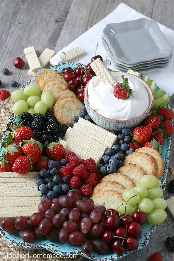 Healthy Fruit Dip with fruit and cookies on board