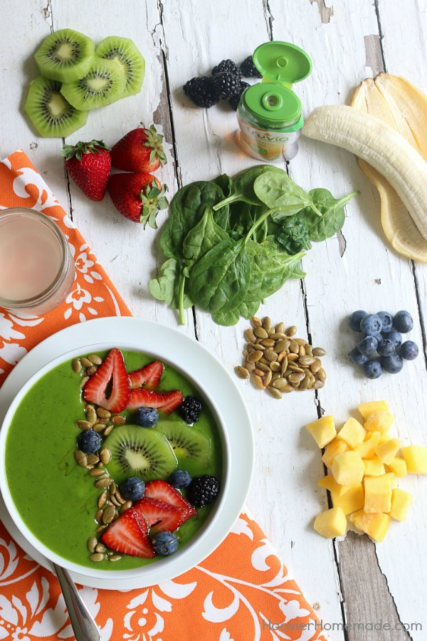 Packed full of flavor and goodness, this Tropical Smoothie Bowl will start your morning off right! Whip up the smoothie in seconds and then add delicious ingredients to the top for a one of a kind breakfast!