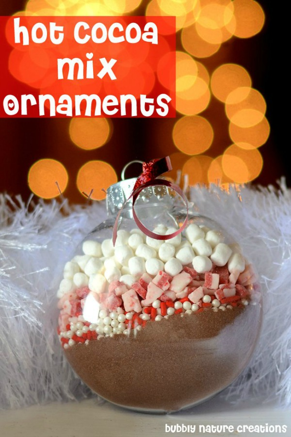 Perfect for gift giving, these Homemade Christmas Ornaments filled with different Hot Cocoa Mixes are EASY to make and inexpensive! Pin this to your Christmas Board!