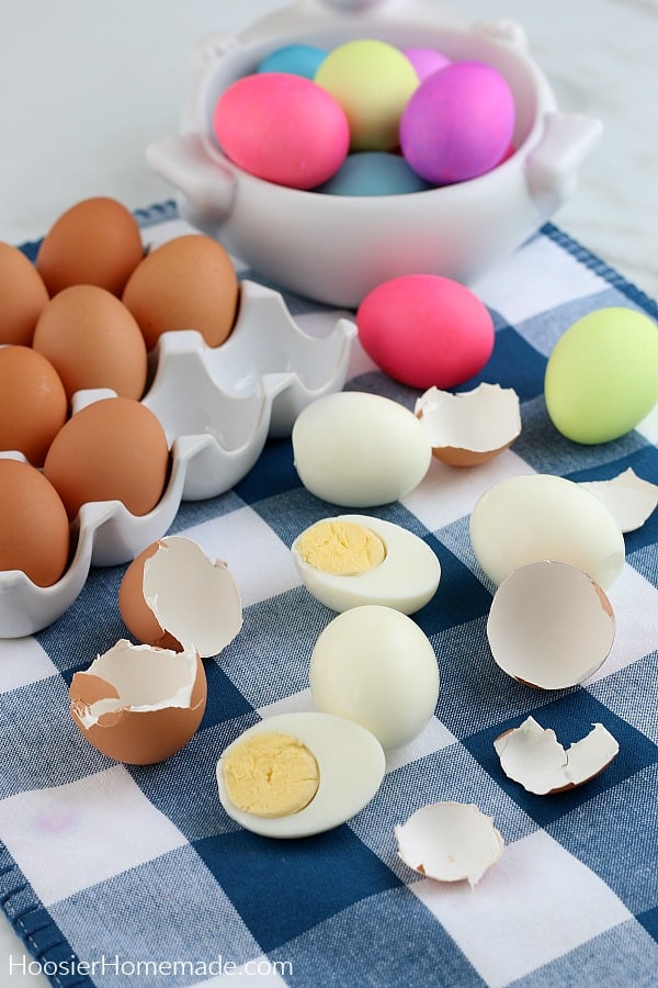Instant Pot Hard Boiled Eggs peeled on blue napkin