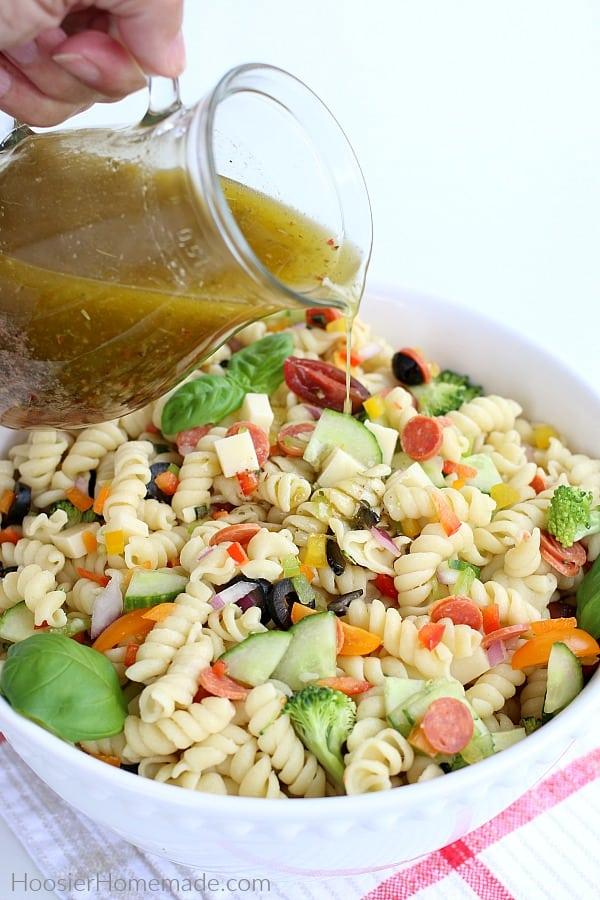Italian Dressing poured on Pasta Salad