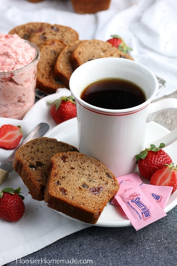 Jam Cake sliced on plate with tea