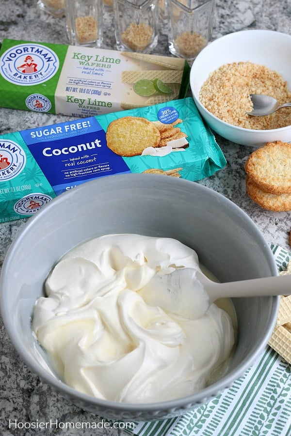 Mixing pudding shots in gray bowl