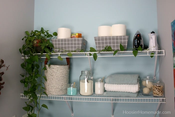 Shelves decorated in Small Laundry Room