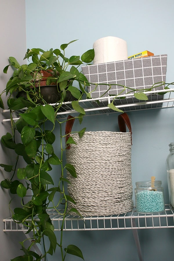 Basket on shelf in small laundry room