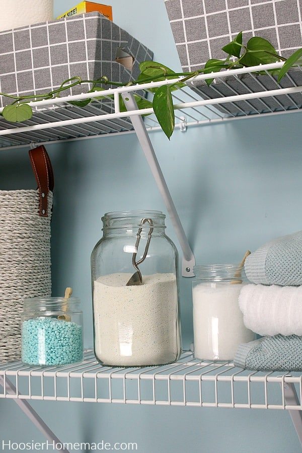 Laundry soap on shelf in small laundry room
