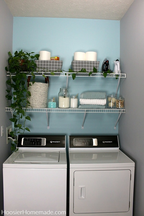 Small laundry room shelves decorated