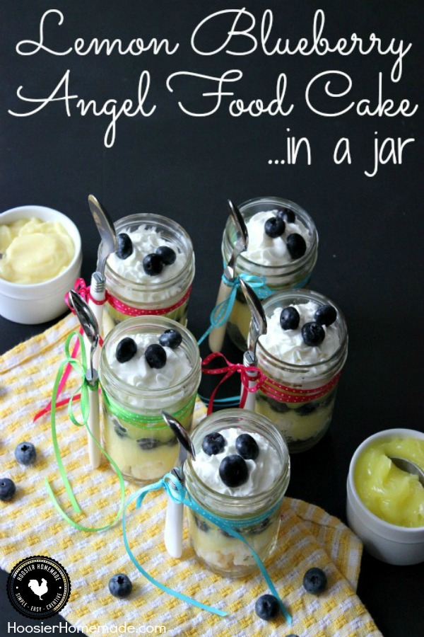 Layers of Angel Food Cake, Lemon Pie Filling, Pudding, Blueberries and topped with Whip Cream - this Lemon Blueberry Angel Food Cake in a Jar makes the perfect Spring Dessert Recipe! Pin to your Recipe Board!