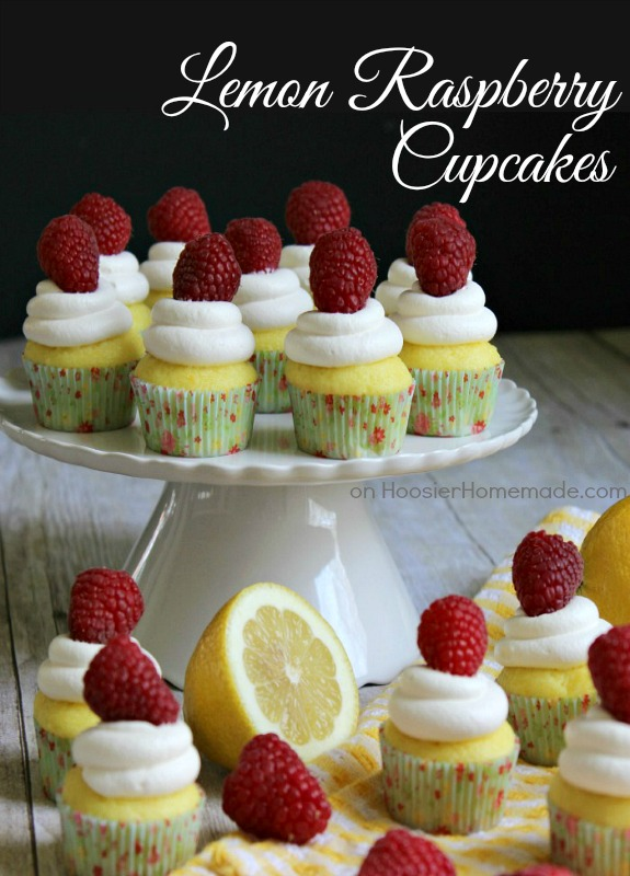 Lemon Cupcakes filled with Red Raspberry Spreadable Fruit! They are baked in mini cupcake liners, making them a sweet little bite, perfect for after dinner! Pin to your Cupcake Board!
