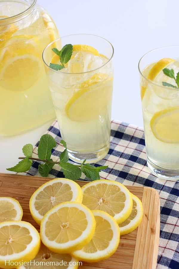 Lemonade Recipe in tall glasses with lemons and mint