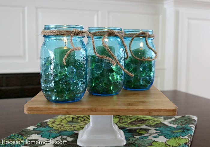 Blue Mason Jars filled with stones and candles