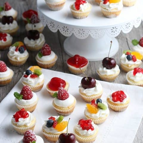 Mini Cheesecakes topped with fresh fruit and whip cream