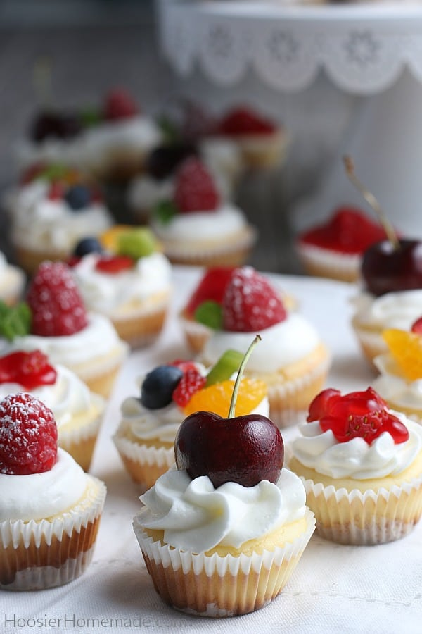 Mini Cheesecakes with whip cream and fruit