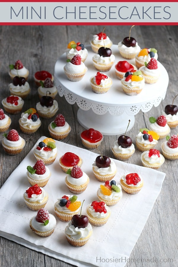 Mini Cheesecakes that are baked and topped with whip cream and fresh fruit