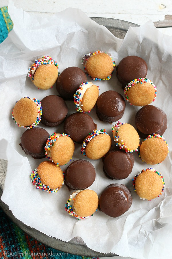 MINI ICE CREAM SANDWICHES -- These bite-size ice cream sandwiches can be put together in minutes! Kids of ALL ages will love them! Dip in chocolate coating, add sprinkles or leave plain!